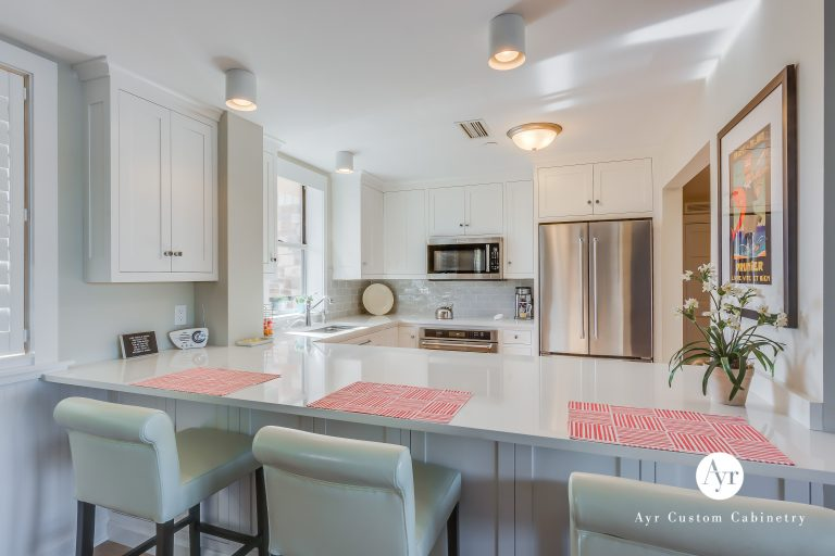 custom kitchen cabinets with bar seating in st joseph