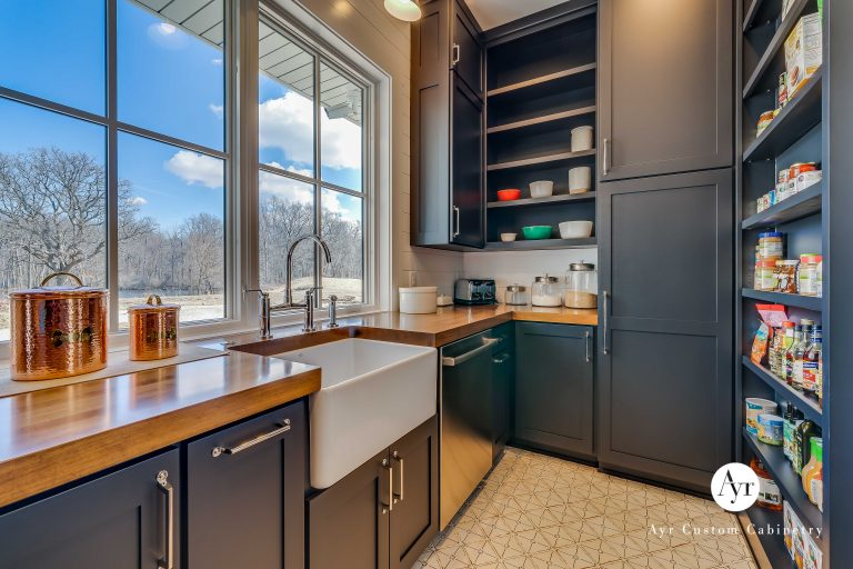 custom butler kitchen, pantry cabinets with a sink