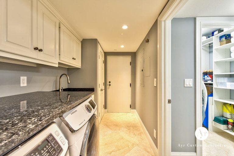 beautiful laundry room custom cabinets