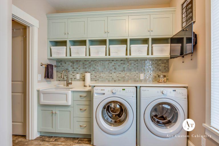custom green laundry room cabinets