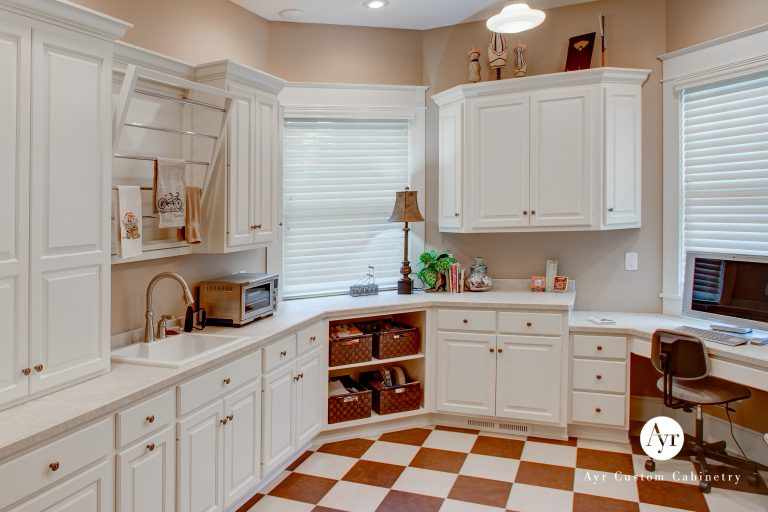 custom library and laundry cabinets