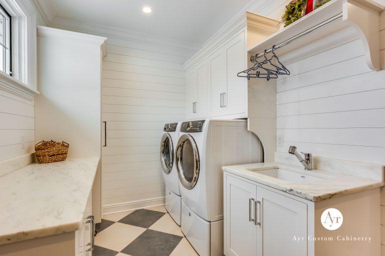 custom white laundry room cabinets
