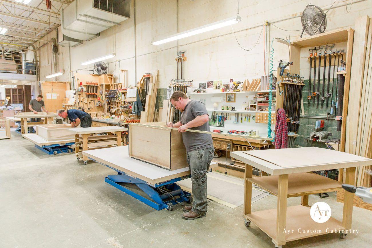 high end kitchen cabinets, men at work